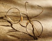 Photo of reading glasses on parchment
